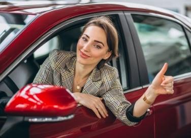 woman-sitting-i-car-car-showrrom